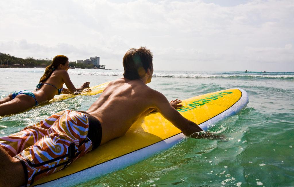 Learn to surf at Waikiki Beach.