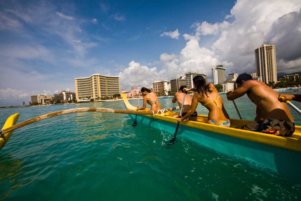 Get a workout canoeing at Waikiki Beach.