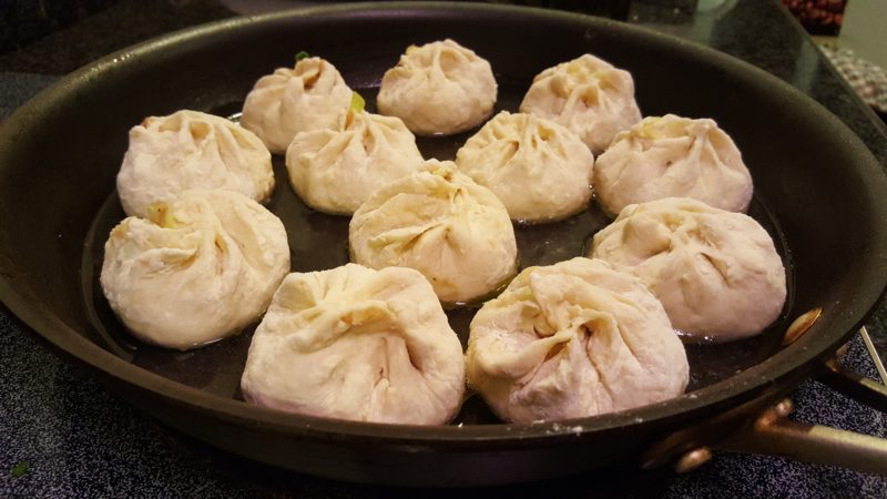 Baozi on the pan with water.