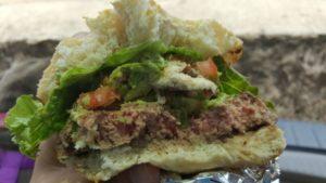 Half-eaten burger from Kua Aina. Hawaii travel. Things to do in Oahu. Things to do in Hawaii.