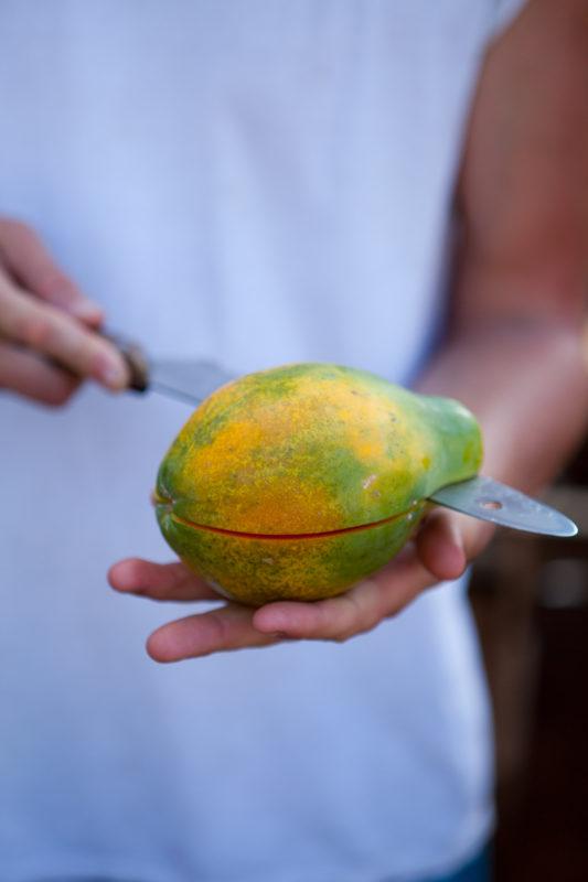 Cutting a papaya