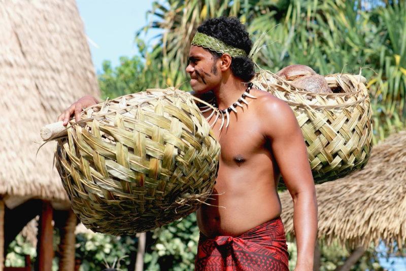 Polynesian Cultural Center carrying handwoven baskets.