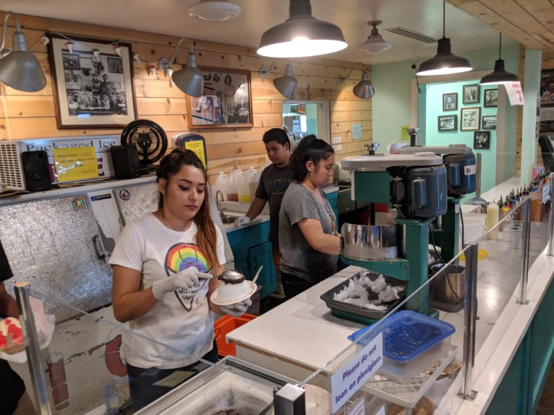 Matsumoto Shave Ice staff hard at work. They have a really good system going on and efficiency is key to serve more than 1000 shave ice each day.