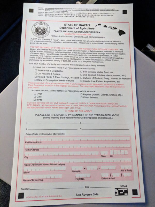 You'll have to fill out this plants and animals declaration form on any flight coming into Hawaii.