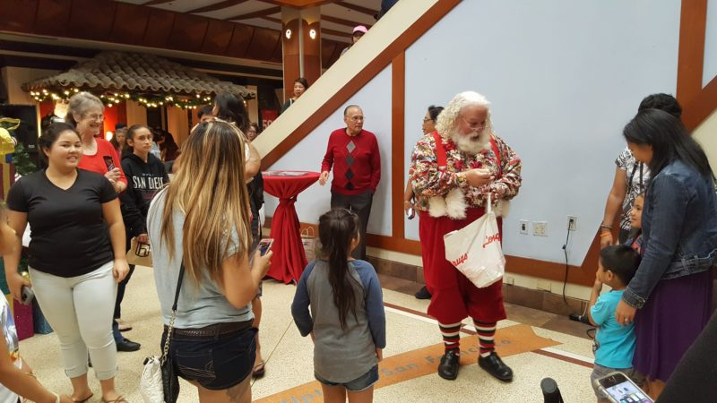 Santa giving out candy at Pearlridge Center - a mall popular with locals.