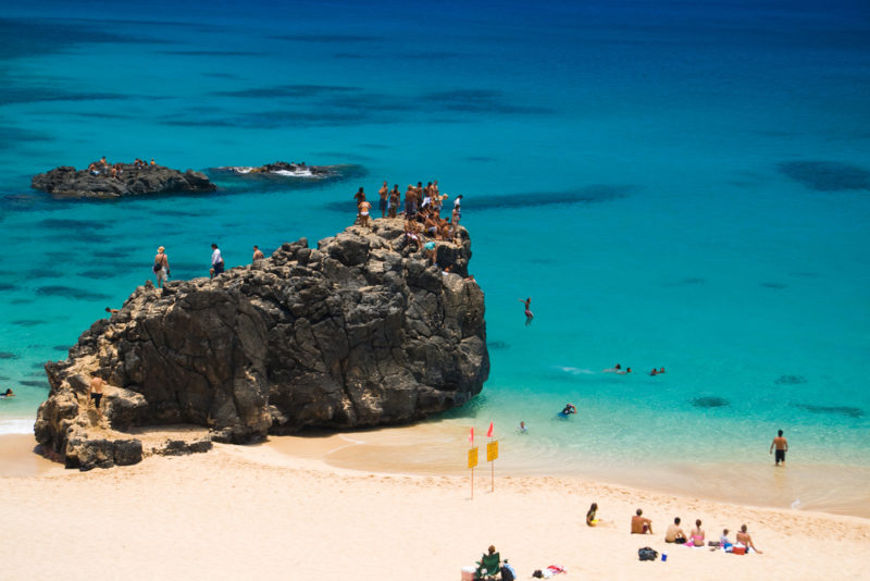 "The ""jumping rock"" at Waimea Bay. The Best Beaches In Oahu's North Shore For Families."