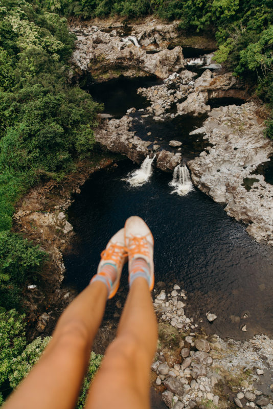Look down below to see your feet and water.