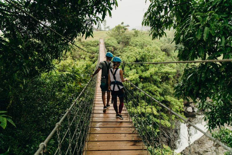 Crossing bridges between ziplines.