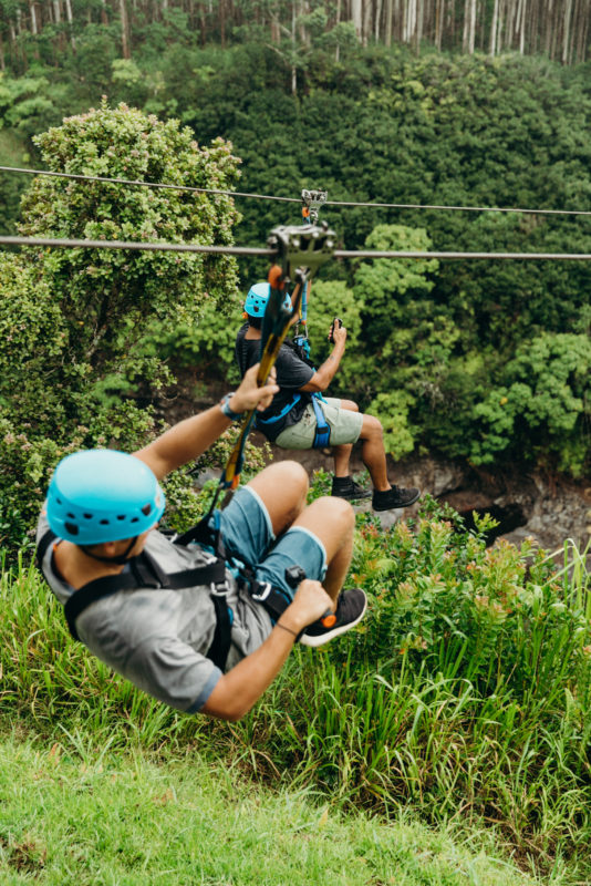Racing down while ziplining in Hawaii.