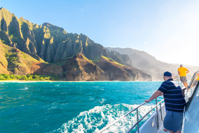 A boat tour of the Na Pali cliffs in Kauai. From the best Hawaiian island to visit for kids.