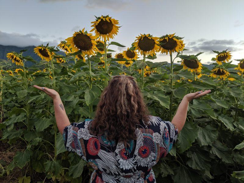 Having a conversation at the Waialua sunflower field.