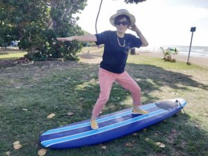 My Aunty on a surfboard for fun at White Plains Beach.
