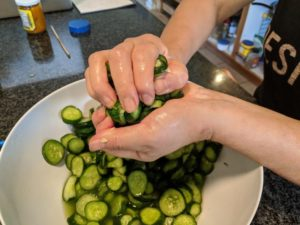 Salt and squeeze the cucumbers.
