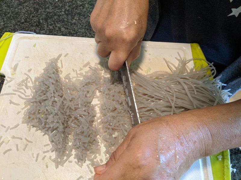 Cut the japchae noodles.