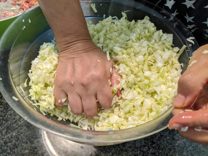 Salt and massage the water out of the green cabbage.