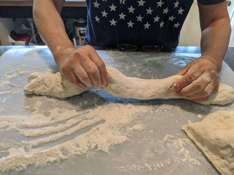 Roll the dough out to a fat noodle.