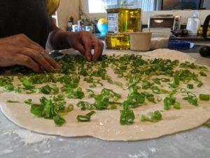 Sprinkle salt, flour, and green onions.