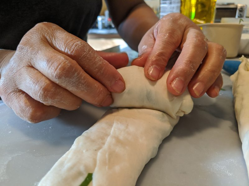 Roll from the fat (cut) end to the skinny end.