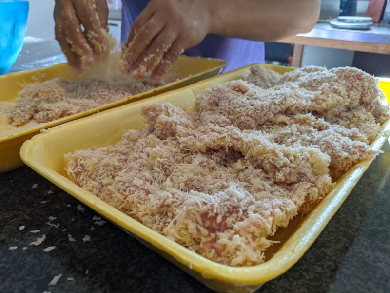 Press the chicken into the breadcrumbs and fill up the holes.
