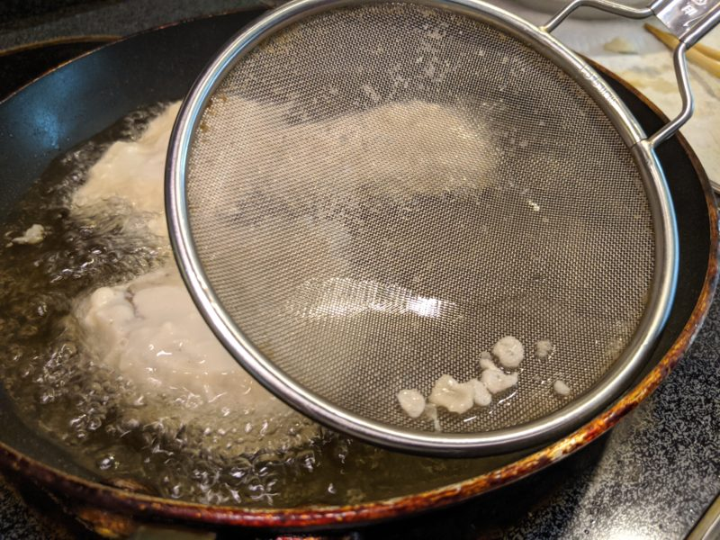 Remove the loose tempura crisps as you cook.