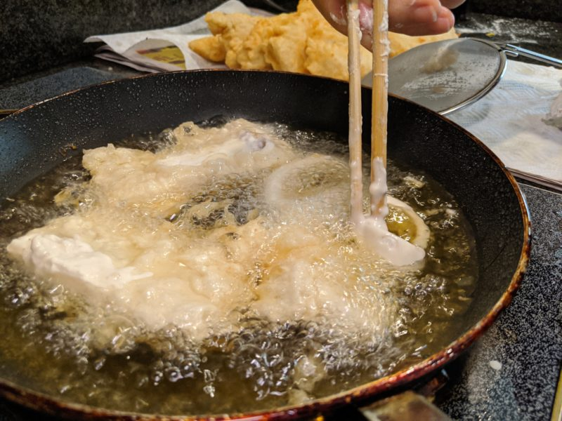 Gently put squid into the hot oil.