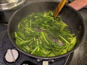 All of the minced pork tofu juices is coating this stir fry. The water is coming out, cleaning the pan, and evaporating.