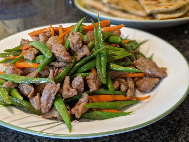 Pork, green beans and carrots stir fry