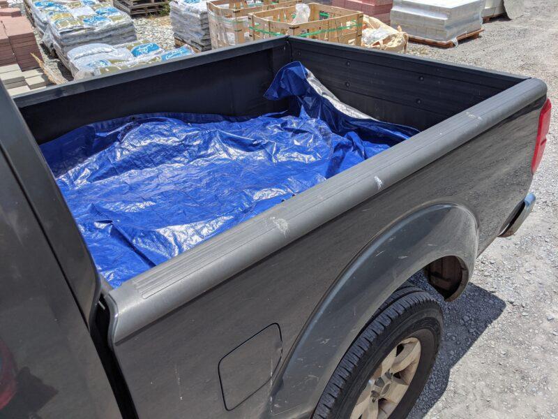 Lining the truck with a heavy-duty tarp.