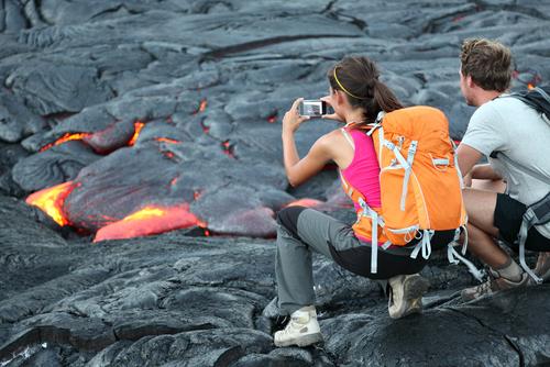 Watching the lava flow from Kilauea Volcano near the Hawaii Volcanoes National Park on the Big Island of Hawaii.
