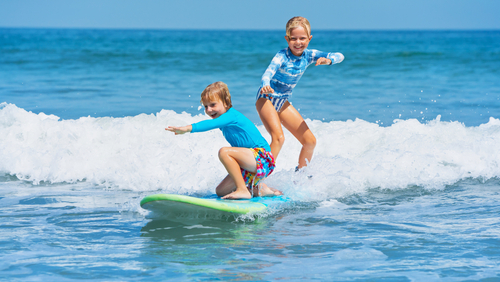 Learning to surf in the summer in Hawaii is a perfect tiem for little kids as the waves are gentle islandwide.