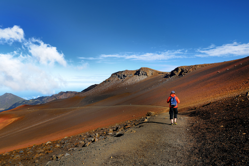 Hiking the Haleakala volcano crater on the Sliding Sands Trail. There's a beautiful view of the crater floor and cinder cones below.