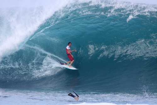 Damien Hobgood competes in the Billabong Pipemasters on December 9, 2011 at Pipeline, Hawaii. Editorial credit: Mana Photo / Shutterstock.com