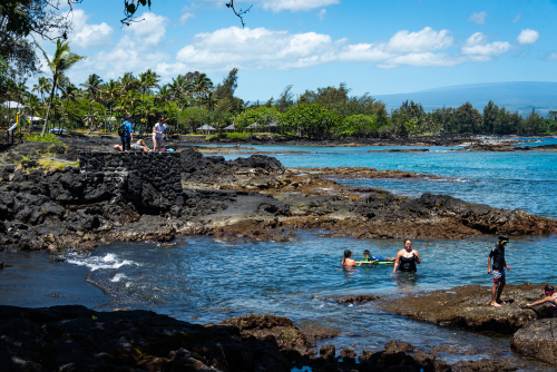 A family enjoying the waters at Richardson Beach Park on the Big Island. Editorial credit: Chris Allan / Shutterstock.com