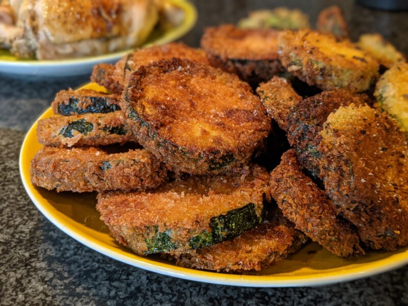 Fried zucchini on a plate. Hawaii recipes, living in Hawaii, things to do in Hawaii.
