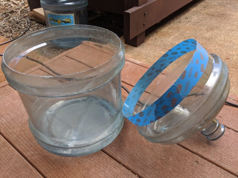 Cut the water jug into two pieces. The bottom is the fish tank and the top is the grow bed.