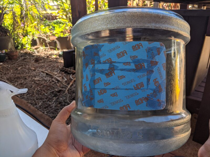 Creating a window before spray painting my fish tank black.