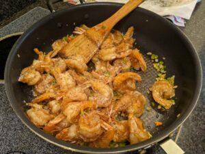 Add the shrimp and stir so the vegetables get stuck on the shrimp. Add salt and pepper to taste.