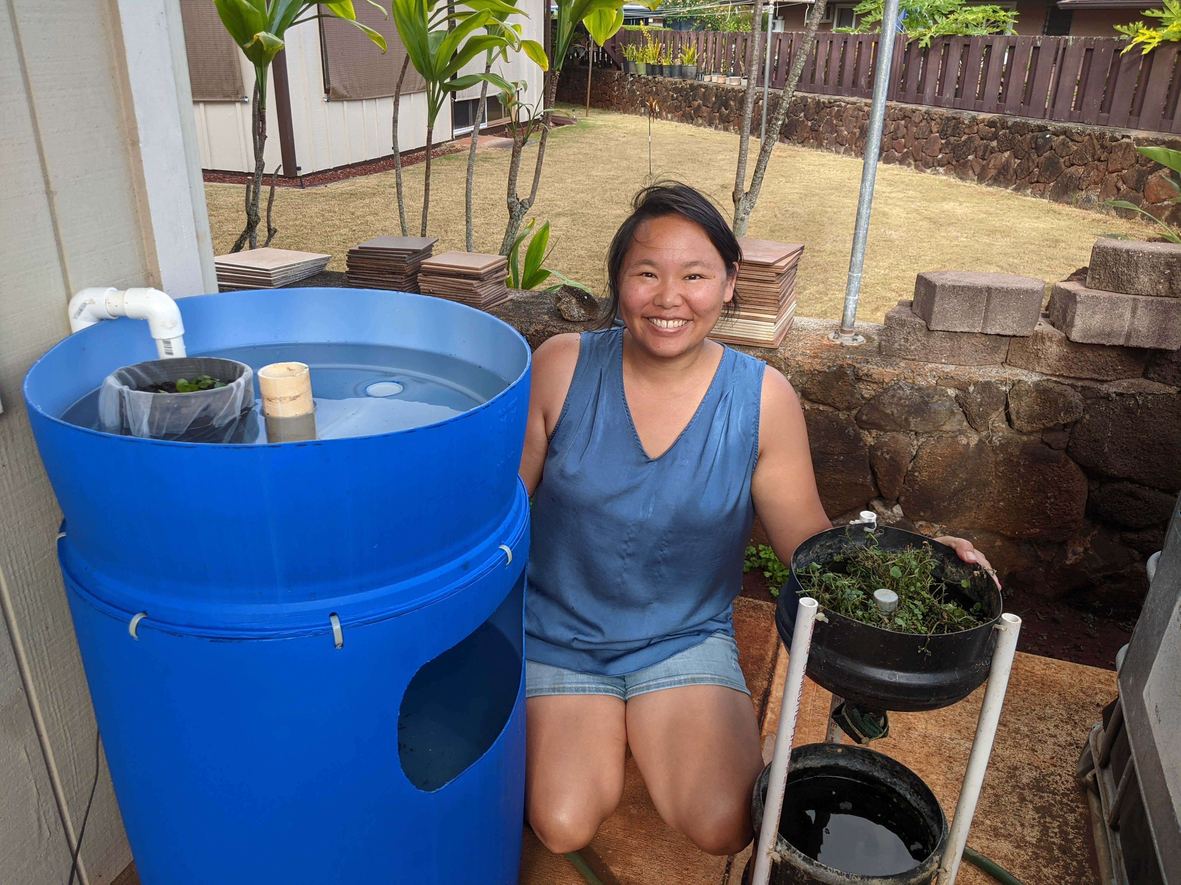 Amy with aquaponic setup.