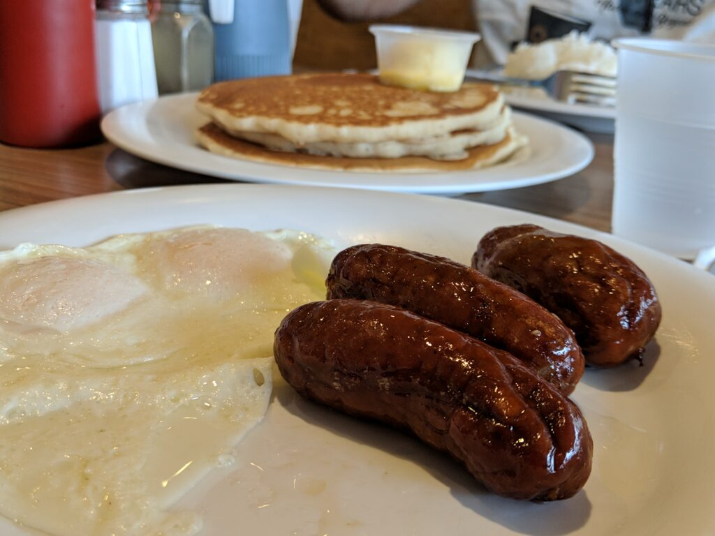 Pancakes, over easy eggs and Scottish bangers.