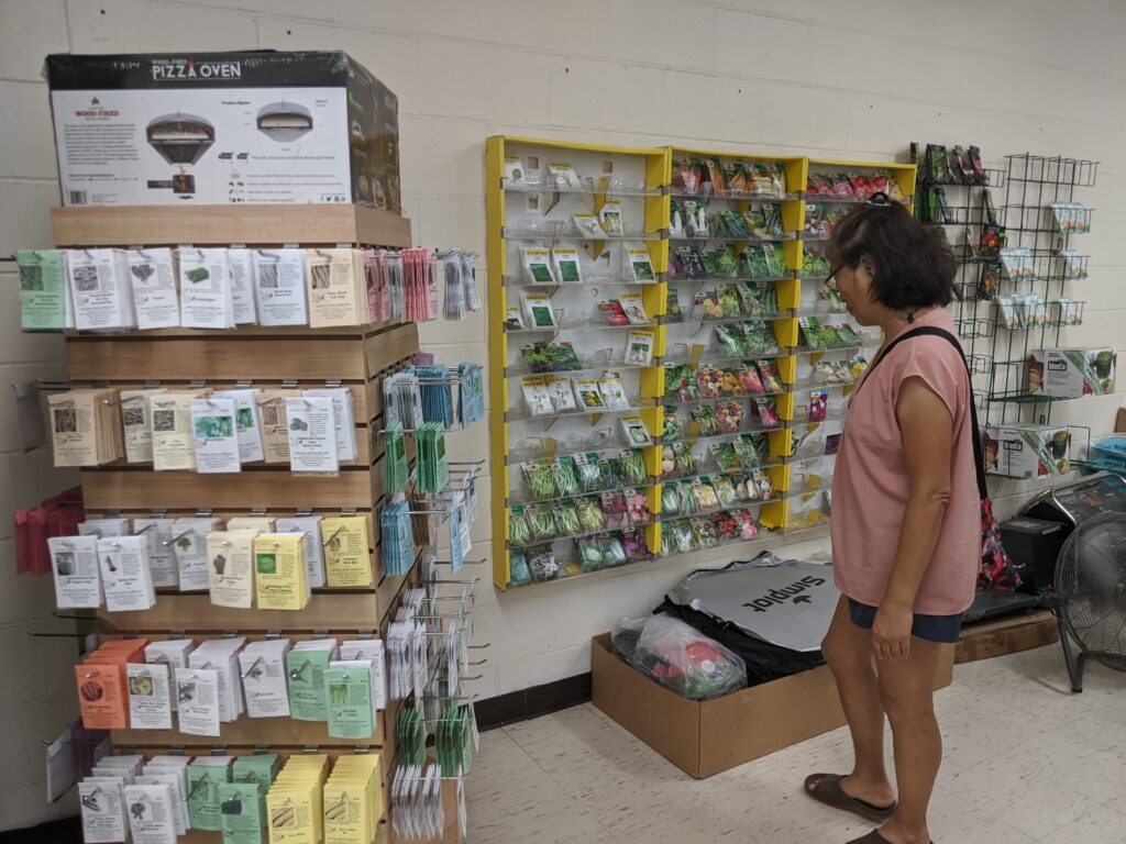 Mom taking a look at the seed variety at Koolau Farmers on South Beretania Street.