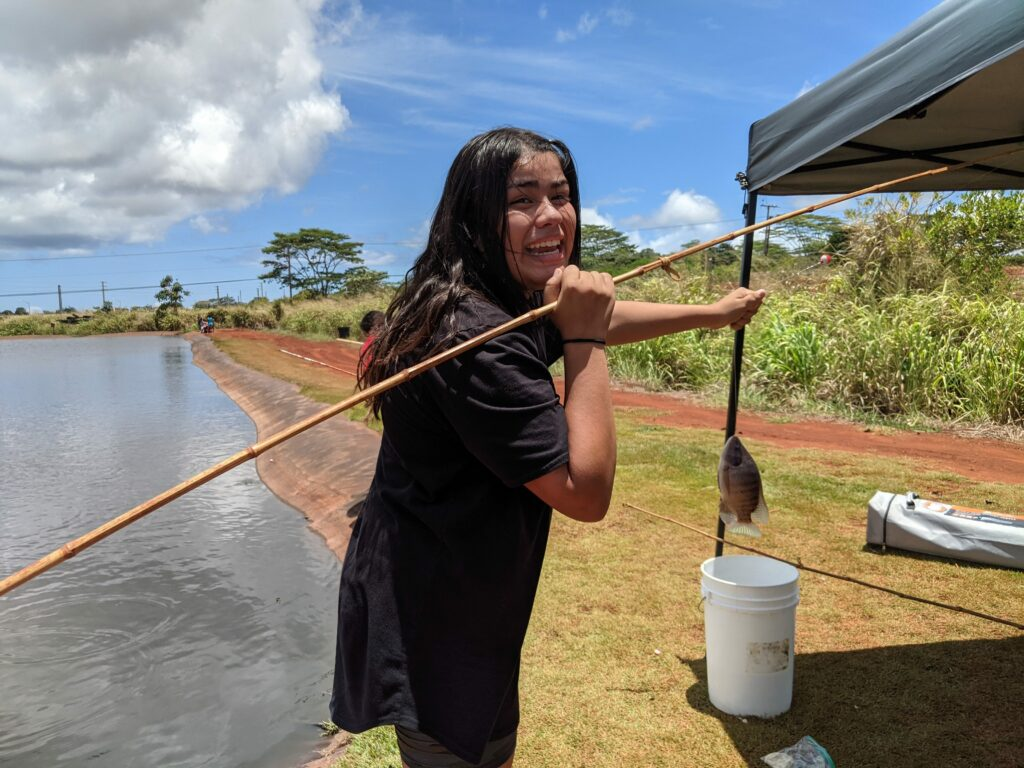 Fishing for the first time at Alii Agriculture farms.